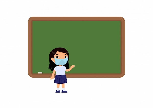 Elementary school pupil with protective mask on her face. school girl standing near blackboard. virus protection, allergies  concept.