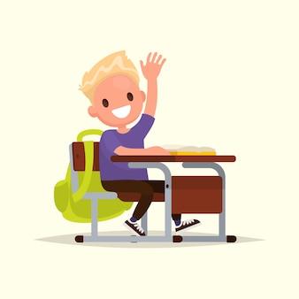 小学生。男子生徒が答えるために手を挙げます。
