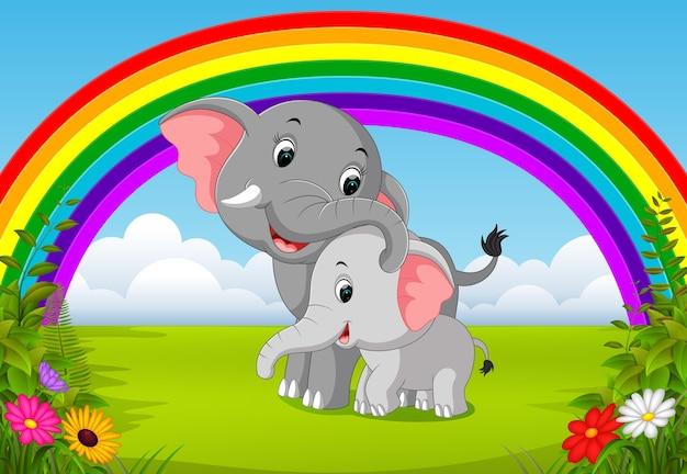 Слон и слоненок в джунглях с радугой