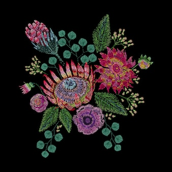 Embroidered composition with wild and garden flowers, buds and leaves. satin stitch embroidery floral design on black background. folk line trendy pattern for clothes, dress, fabric, decor.