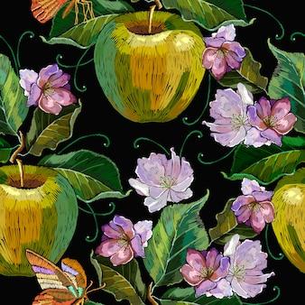 刺繍リンゴと蝶のシームレスパターン