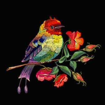 Embroidery, bird and wild roses flowers