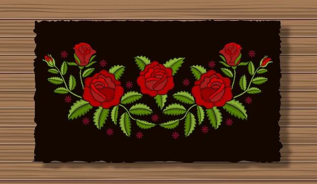 暗いフラップ布と木製のテクスチャ背景に小枝と刺繍の花。ステッチバラの花飾り