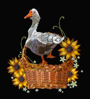 Embroidery goose in a wicker basket with sunflowers