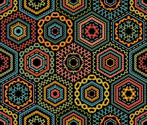 Embroidery seamless pattern. high detailed stitches. colourful embroidered hexagons on black background. ethnic textile boundless background.