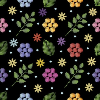 Embroidery seamless pattern with flowers.