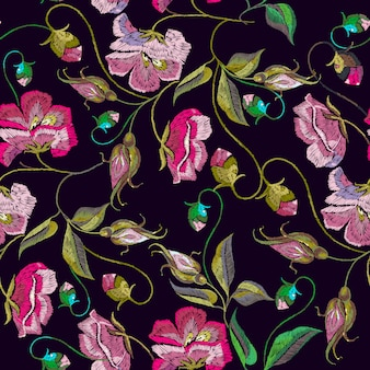 Embroidery spring flowers seamless pattern