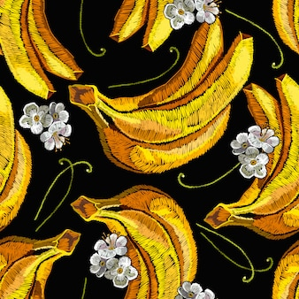 Embroidery white flowers and yellow tropical bananas