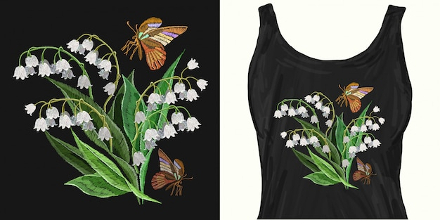 Embroidery white snowdrops flowers and butterfly.