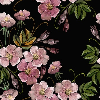 Embroidery wild pink flowers seamless pattern