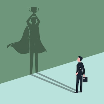 Employee businessman sees himself shadow as winner superhero