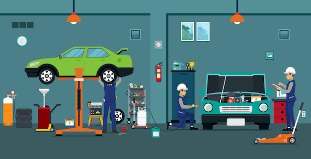 従業員はガレージで車をチェックして修理しています