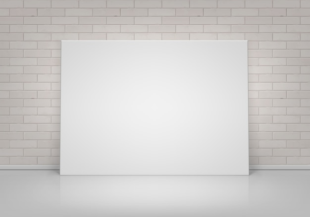 Empty blank white mock up poster picture frame standing on floor with brick wall front view