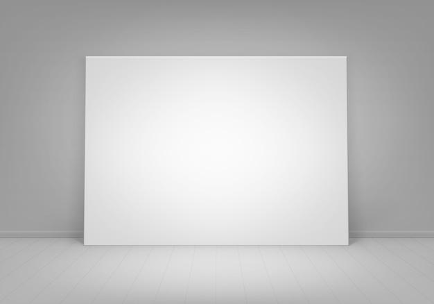 Пустой пустой белый макет фоторамки плаката, стоящей на полу с видом на стену спереди