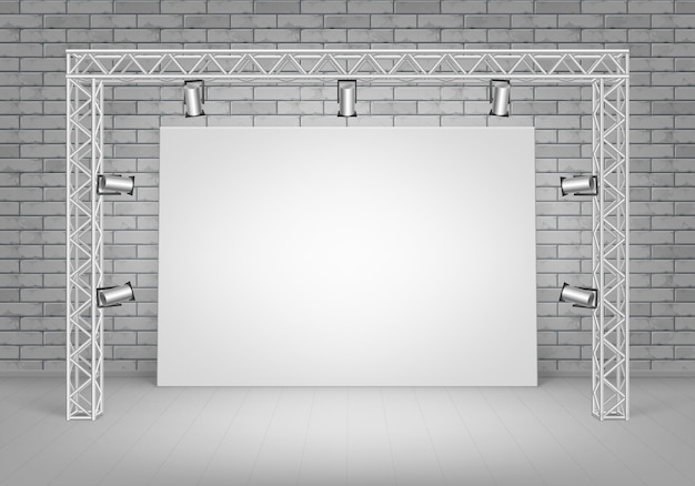 Empty blank white mock up poster picture standing on floor with gray brick wall and spotlights illumination front view