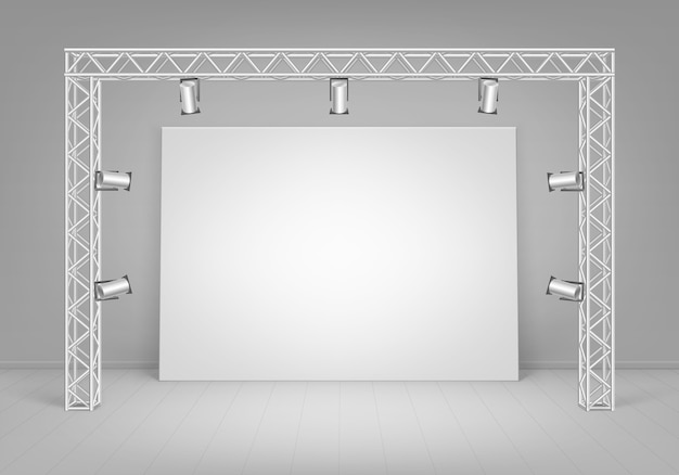 Empty blank white mock up poster picture standing on floor with wall and spotlights illumination front view