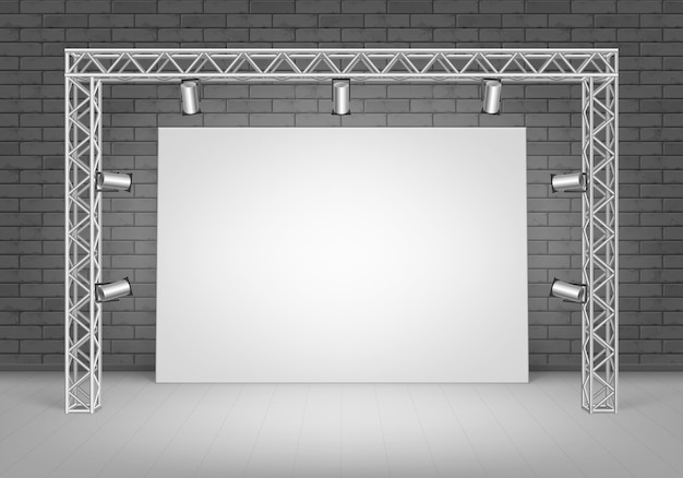 Empty blank white  poster picture standing on floor with black brick wall and spotlights illumination front view
