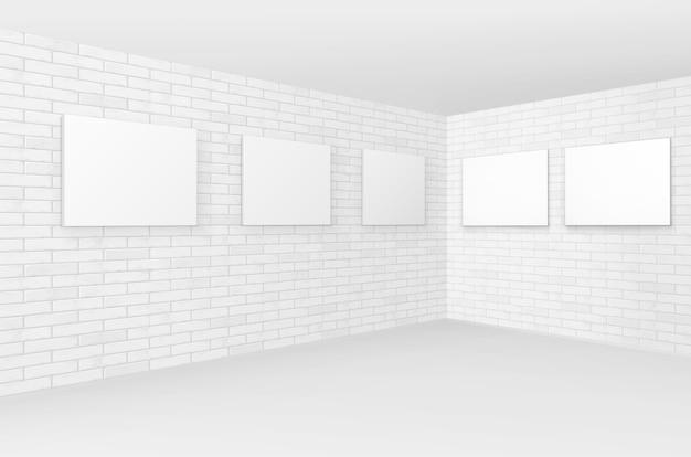 Пустые пустые белые плакаты в рамке для фотографий на кирпичных стенах