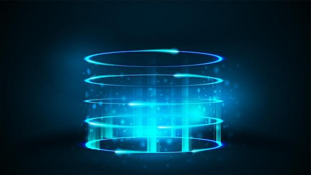 어두운 방에 입자와 반짝이는 고리가 있는 원통형 모양의 빈 파란색 네온 디지털 홀로그램