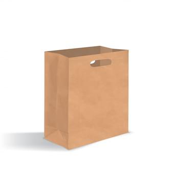ハンドル穴付きの空の茶色の紙袋。白い背景で隔離の影と現実的なクラフトパッケージ。デザインテンプレート。