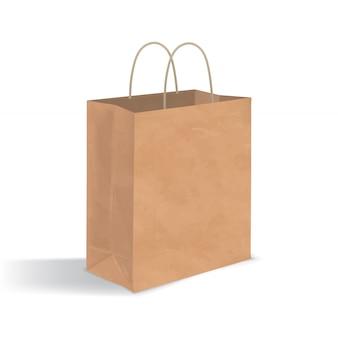 ハンドル付きの空の茶色の紙袋。白い背景で隔離の影と現実的なクラフトパッケージ。デザインテンプレート。