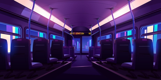 Empty bus or train interior with chairs, handrails and windows at night.