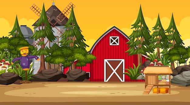 赤い納屋と風車のある日没時のシーンで空の農場
