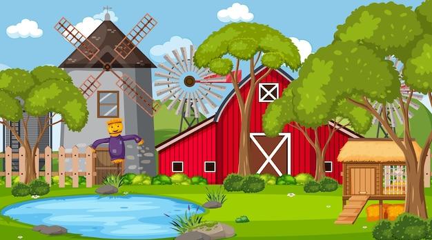 빨간 헛간과 풍차가 있는 빈 농장 현장