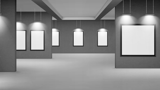 Empty gallery with blank picture frames illuminated by spotlights.