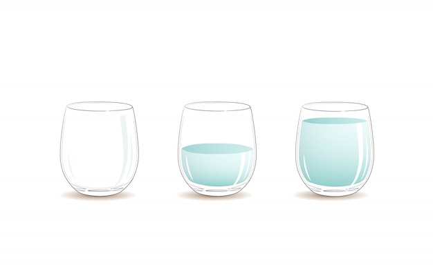 Empty glass, half full and full glass of clear cold water.