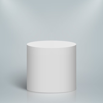 Empty illuminated round podium or platform. whiite blank cylinder