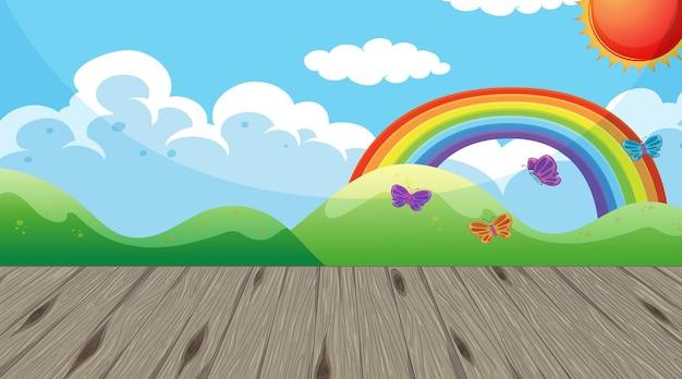 Stanza dell'asilo vuota con carta da parati arcobaleno nel cielo