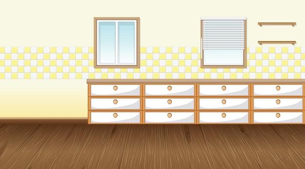 カウンターキャビネットと寄木細工の床の空のキッチンルーム