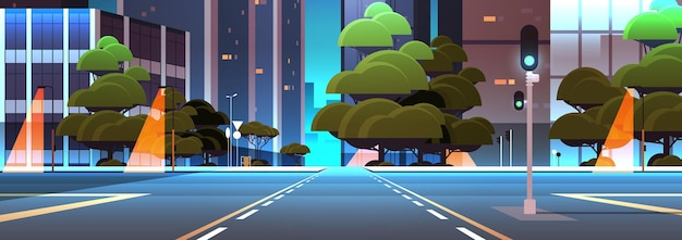 Empty night street road with crossroad and traffic lights city buildings skyline modern architecture cityscape