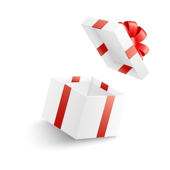 Empty open white gift box with red ribbon, bow and flying cover.