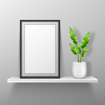 Empty photo frame stand on white shelf