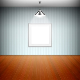 Empty picture frame illuminated by spotlight