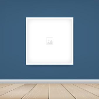 Пустая рамка на синем фоне стены