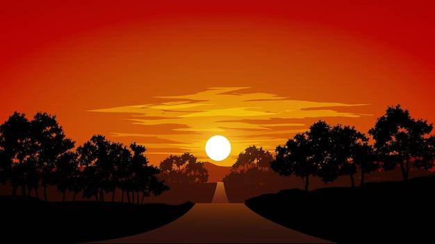 Пустая дорога в лесу на закате