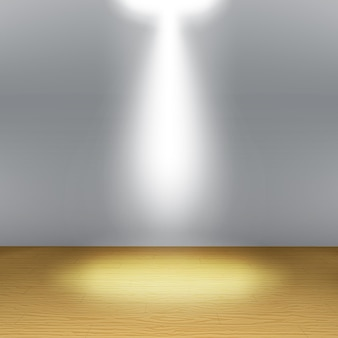 空の部屋、スポットライトとリアルな木の床のある灰色の壁。ショールームのコンセプト。