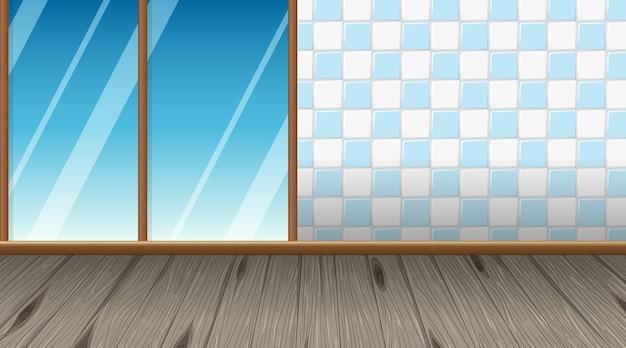 寄木細工の床とスライド式パティオドアのある空の部屋