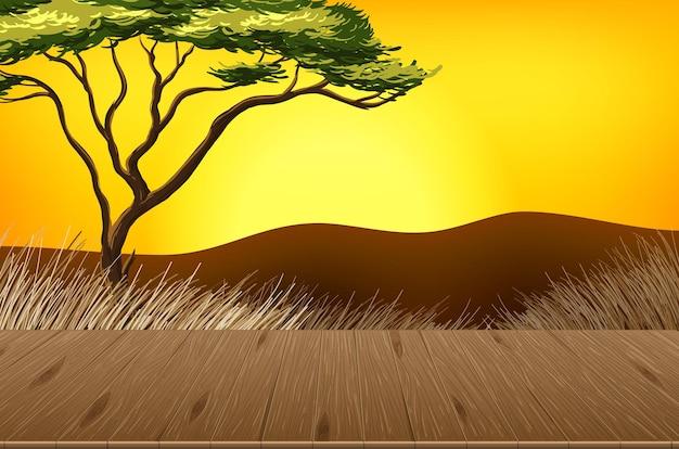 背景がぼやけている空のサバンナの森の風景シーン