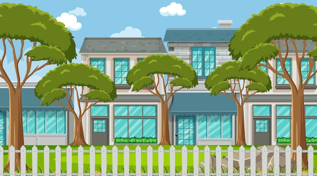 多くの家の背景にいくつかの木がある空のシーン