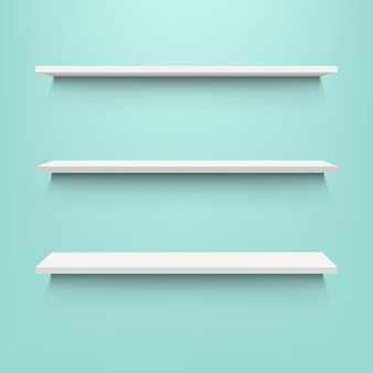 Empty shelves with mint background