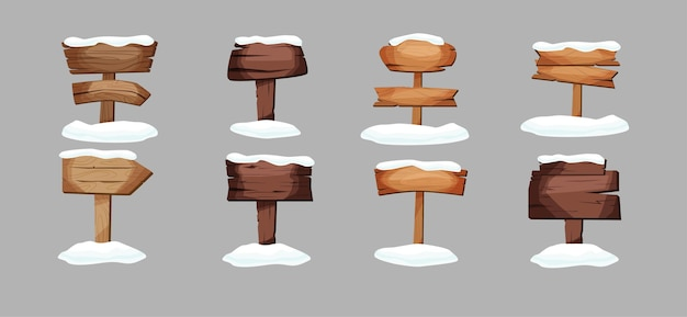 Empty signboards or wood planks of different colors and textures with snow on it.