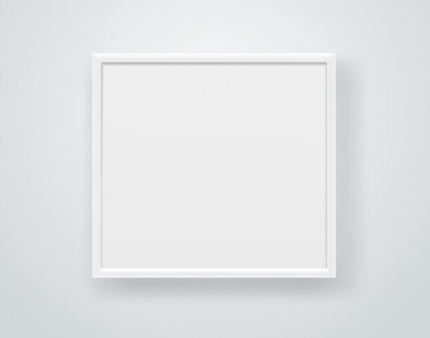 Empty square white frame on a wall.