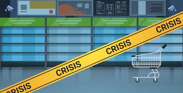 Empty supermarket shelves with yellow crisis tape coronavirus pandemic quarantine  concept