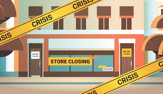 Empty supermarket with yellow closing tape coronavirus pandemic quarantine  concept
