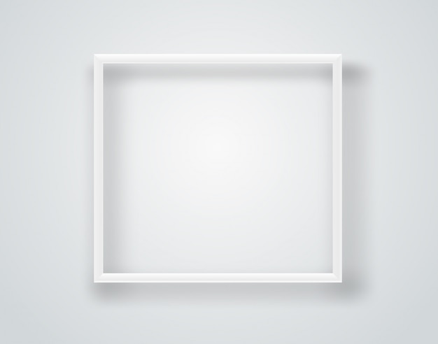 Empty white frame on a wall.