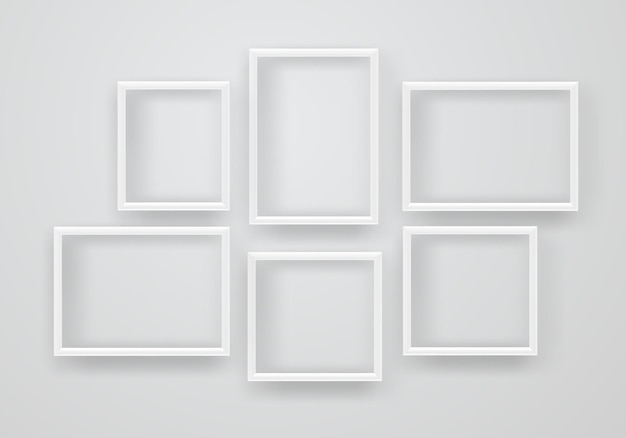 Empty white frames on a wall